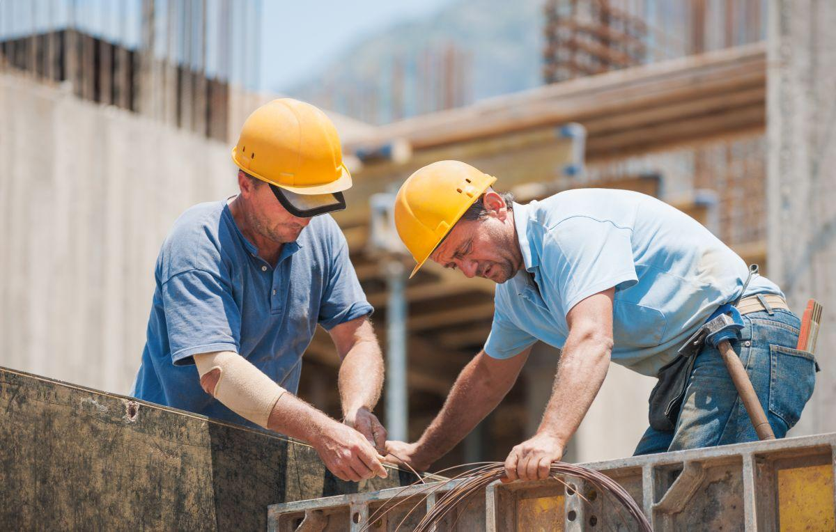 Men Working on Construction Site with Builder's Risk Insurance in Marion, Morganton, Asheville, Gastonia, Old Fort, Spruce Pine, Lake James, NC
